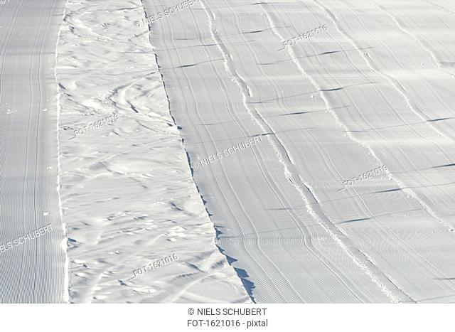 High angle view of freshly groomed corduroy covers ski trail