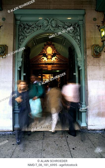 People walking through an archway, Fortnum and Mason Department Store, London, England