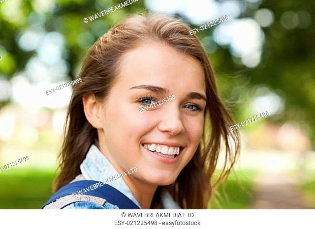 Pretty cheerful student smiling at camera