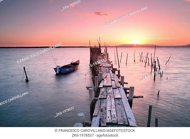 The ancient wooden piers of Cais Palafítico da Carrasqueira close to Alcacer do Sal in Portugal photographed at sunset