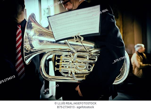 Detail of unrecognizable musician with tubasheet music during Holy Week celebrations, Mahon, Menorca, Baleares, Spain