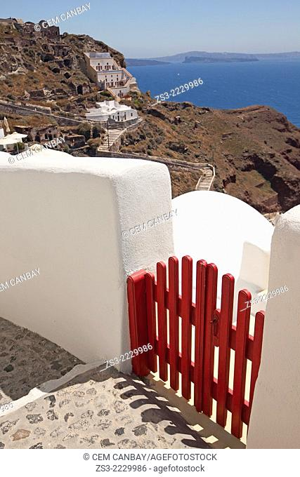 Entrance of a of a Cyclades house with a red fence and at the background Caldera, Oia, Santorini, Cyclades Islands, Greek Islands, Greece, Europe