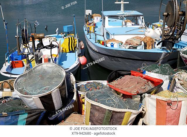 fishing boats and nets in ayia napa harbour republic of cyprus