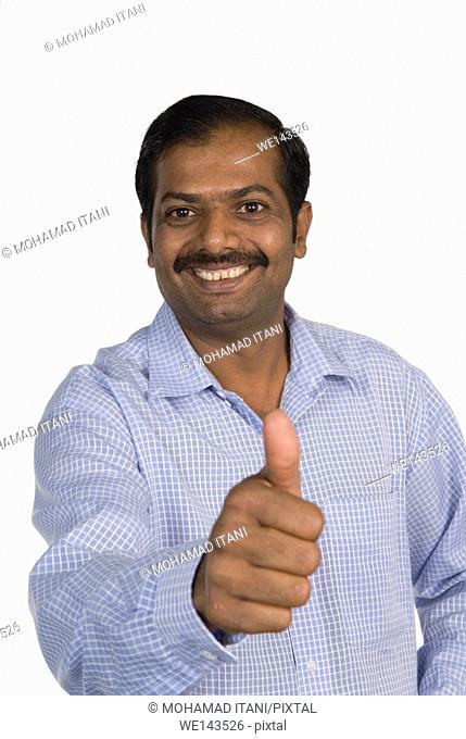 Mature Indian man thumbs up