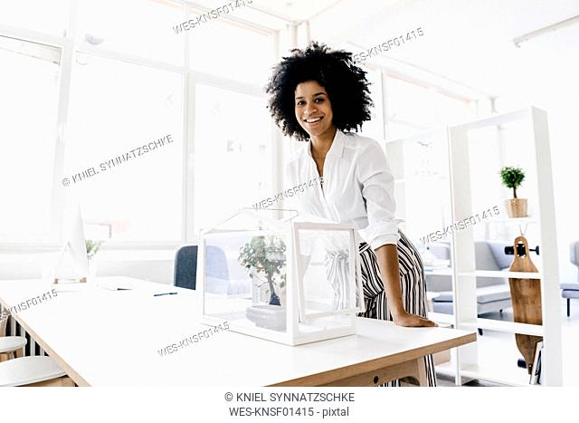 Young woman working in sustainable office