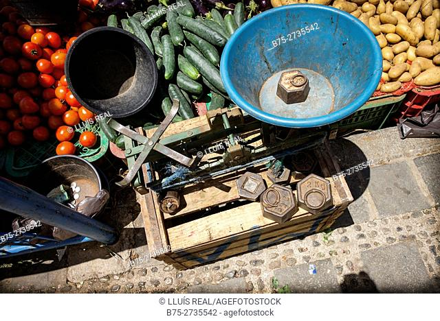 Old scales and vegetables in street market. Chaouen, Morocco