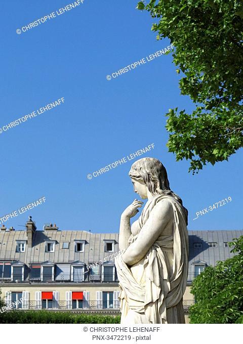 France, Paris. 1st arrondissement. Jardin des Tuileries. Sculpture Vestal by Pierre Legros II. Parisian buildings in the background