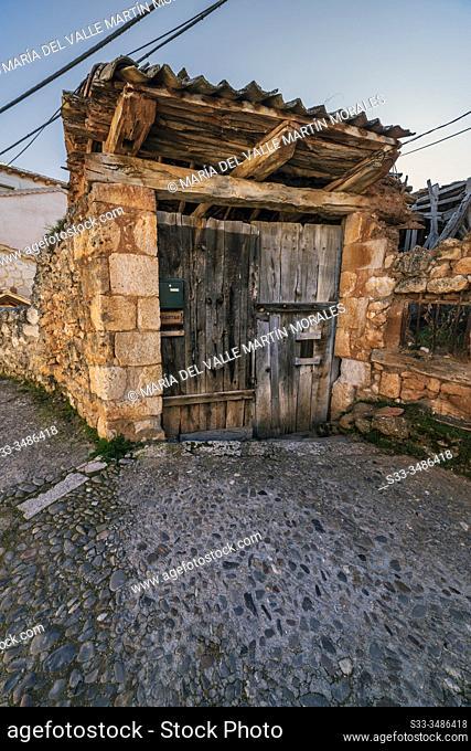 Old rural wooden door in Maderuelo. Segovia. Spain. Europe