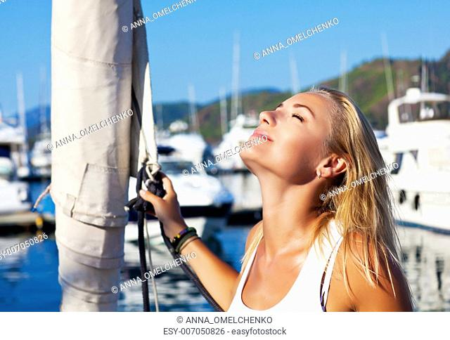 Beautiful woman sailing, young adult lady enjoying summer travel, close-up portrait on sexy female face, summer cruise holidays
