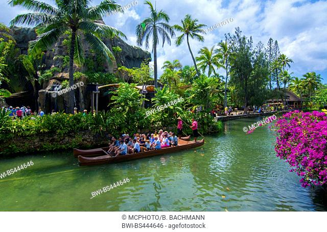 Center tourist boats on canals of the Laie Hawaii Polynesian Cultural Center, USA, Hawaii