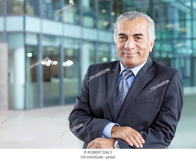 Portrait confident, smiling senior businessman