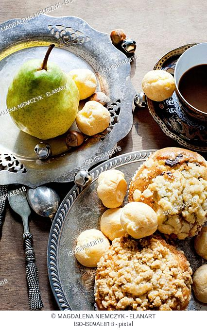 Muffins and pastry puffs with a pear