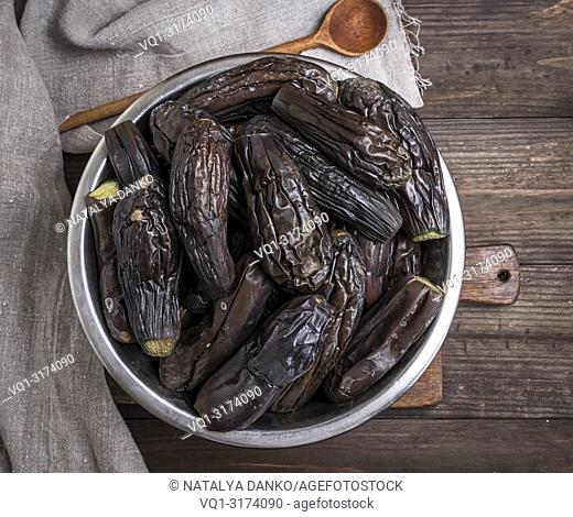 boiled eggplants in an iron bowl, top view
