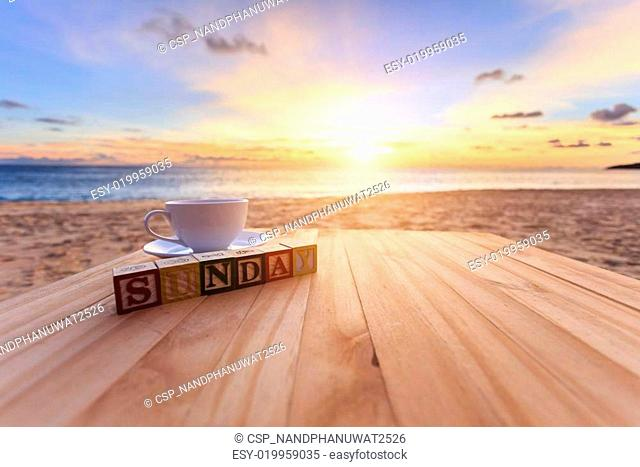 Text wood block and coffee cup on wood table