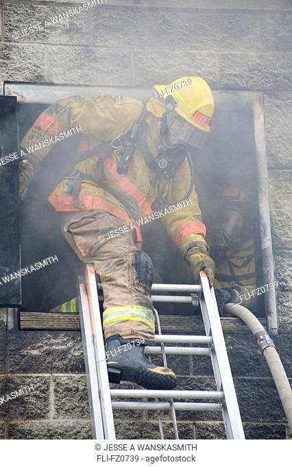 Firefighters exit a building during training, Spokane, Washington
