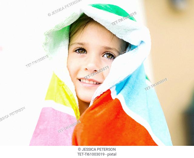 Portrait of smiling girl (4-5) in colorful towel