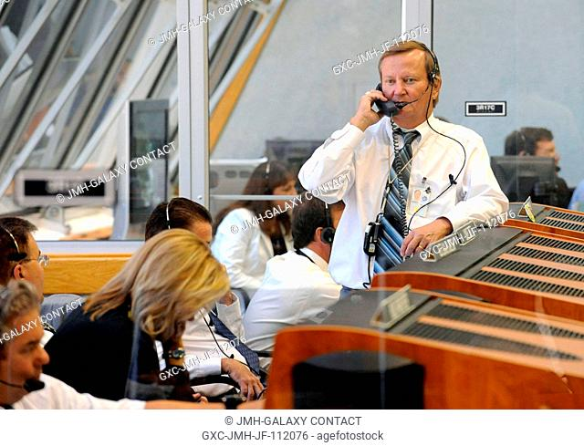 NASA Shuttle Launch Director Michael Leinbach talks on the phone in the Launch Control Center prior to the launch of the Space Shuttle Discovery (STS-124) on...