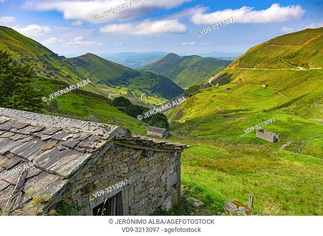 Nature landscape. Cabañas pasiegas and meadows. Cottage in Valles pasiegos. Cantabria, Northern Spain, Europe