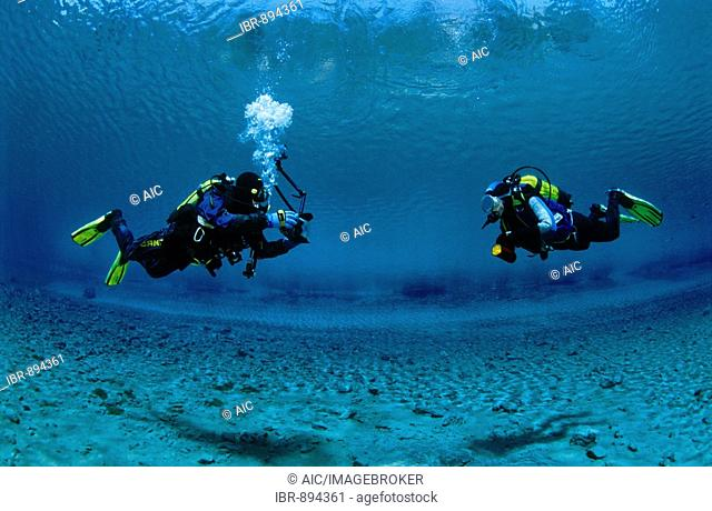 Two divers, an underwater photographer and his model, Tragoess, Styria, Austria, Europe