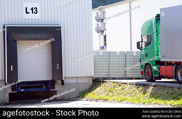05 August 2020, Mamming: Stacked pallets are standing on the premises of a cannery where employees have been infected with the corona virus