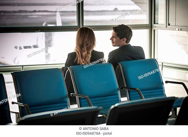 Businesspeople waiting in airport departure lounge
