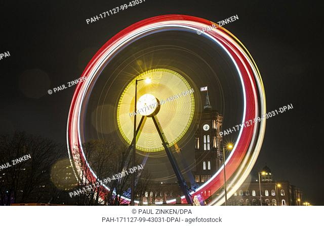 A Ferris wheel turns at the Roter Rathaus Christmas market in front of the television tower in Berlin, Germany, 27 November 2017