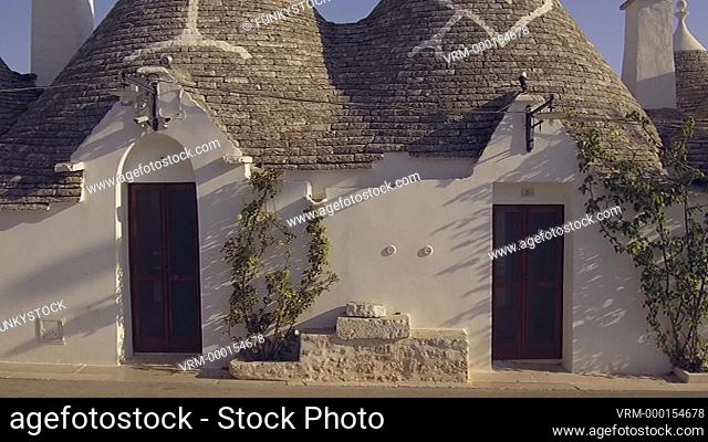 Alberobello, Apulia, Italy : painted traditional symbols on a conical beehive shaped roof of the stone built historical trullo traditional of Alberobello