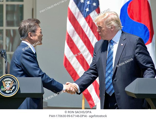 United States President Donald J. Trump and President Moon Jae-in of the Republic of Korea shake hands as they make joint statements in the Rose Garden of the...