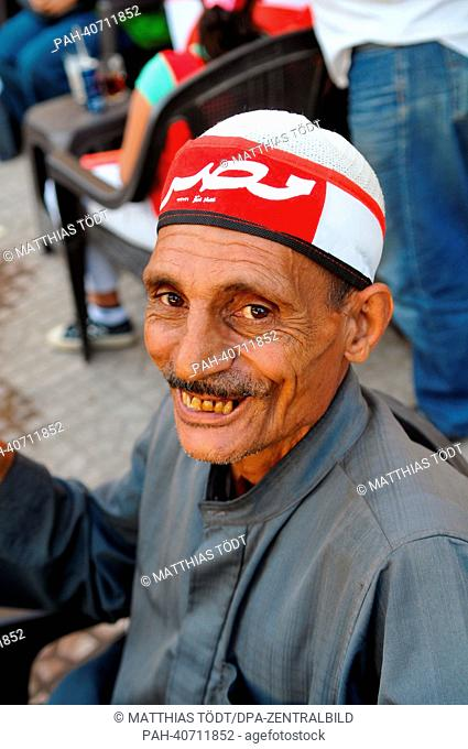 An old man wears a headband with the lettering 'Egypt' during a demonstration at Tahrir Square in Cairo, Egypt, 28 June 2013