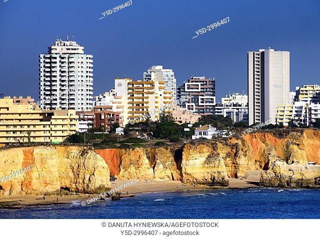 View from z Ponta João de Arens for Praia do Vau, Praia dos Careanos and Praia dos Três Castelos, hotels and apartment buildings on cliffs above beaches
