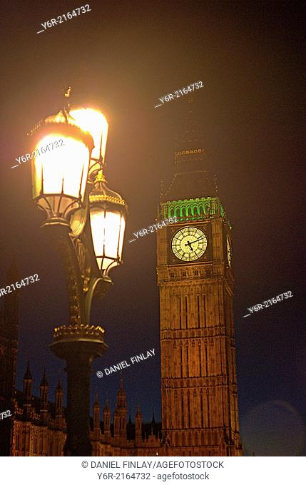 Big Ben and Victorian street lamp at night in Westminster, London, England