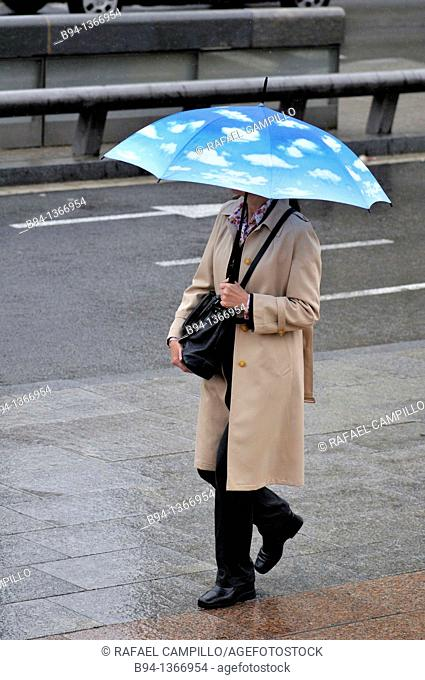 Woman with umbrella. Barcelona, Catalonia, Spain