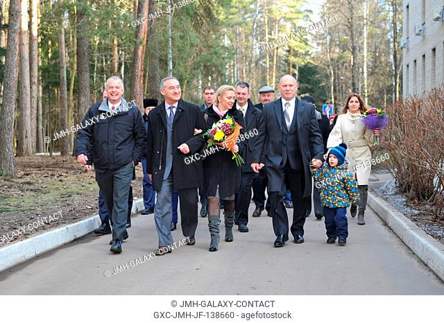At the Gagarin Cosmonaut Training Center in Star City, Russia, the Expedition 3940 prime crewmembers and family members walk to a bus March 13 before boarding a...