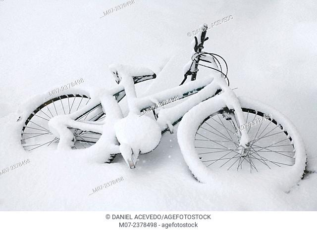 bicycle covered by snow in a snowy day. Spain