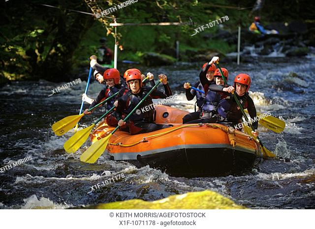 Group of people white water rafting on the Trwyeryn river, National White Water Centre, near Bala Gwynedd north wales UK