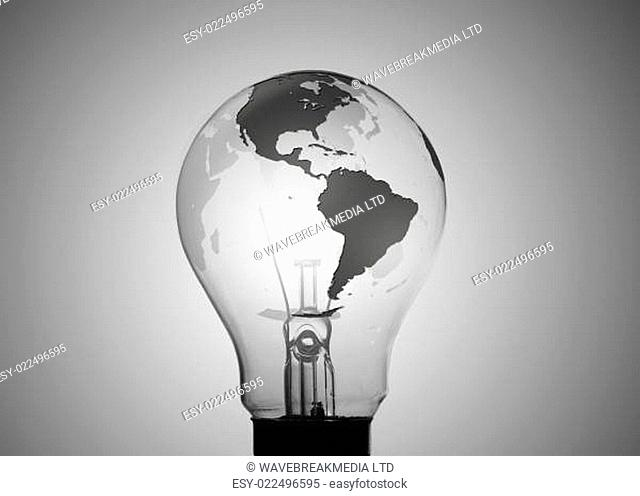 Light bulb with map of earth on its surface