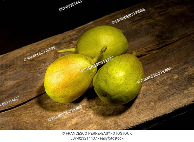 autumn fresh pears over old wood board