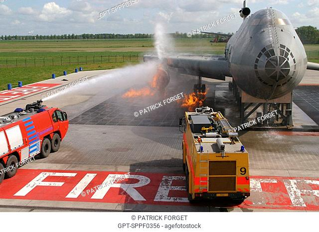 TRAINING DUTCH FIREFIGHTERS WITH AN AIRPLANE FIRE SIMULATOR, MODEL OF A BOEING 747, SCHIPHOL AIRPORT, AMSTERDAM, NETHERLANDS
