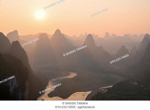 Sunset over Karst peaks with Li river (Lijiang) view from hilltop of Mt. Laozhai (Laozhaishan/Old fortress hill), Xingping, Yangshuo, Guilin, Guanxi, PRC