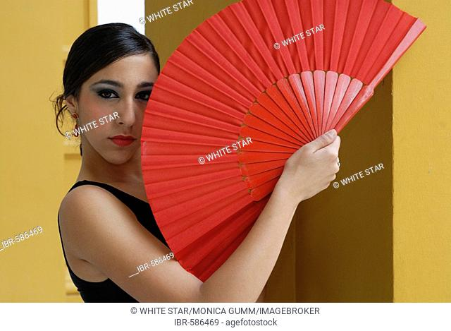Flamenco dancer Triana with fan in the Conservatorio de Danza, Sevilla, Andalusia, Spain, Europe