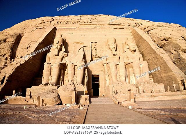 Statues of pharaoh Ramesses II on the outer facade of the Great Temple at Abu Simbel in Egypt