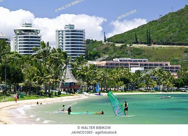 New Caledonia, Grande Terre Island, Noumea, Anse Vata resort area and windsurfers