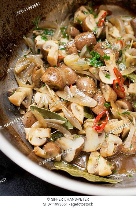 Greek-style marinated mushrooms with onion and chilli