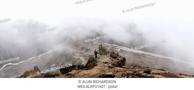 Woman looking at Dingboche, Himalayas, Solo Khumbu, Nepal