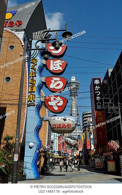Osaka (Japan): people hanging out in Shin-Sekai, with the Tsuten-kaku Tower in the background