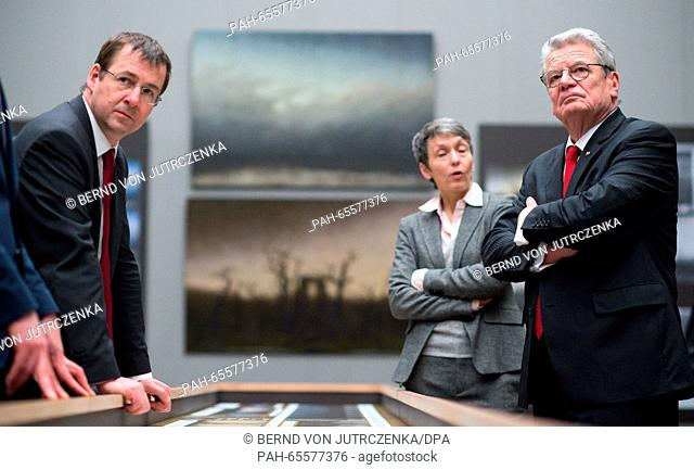 German President Joachim Gauck, and head of the Federal President's Office, David Gill (l), are guided by restorer Kristina Moesl (c) through the special...