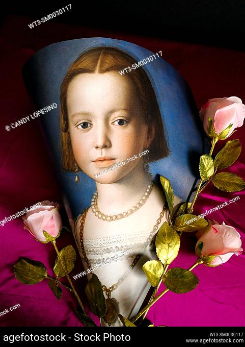 Children in Art, portrait of Bia de Médicis painted by Agnolo Bronzino in the year 1542, on dark pink background and three roses