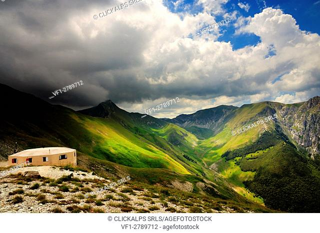 "Fargno refuge, in the backgronud """"pizzo tre Vescovi"""" mountain, Sibillini mountains National Park, Marches, Italy"