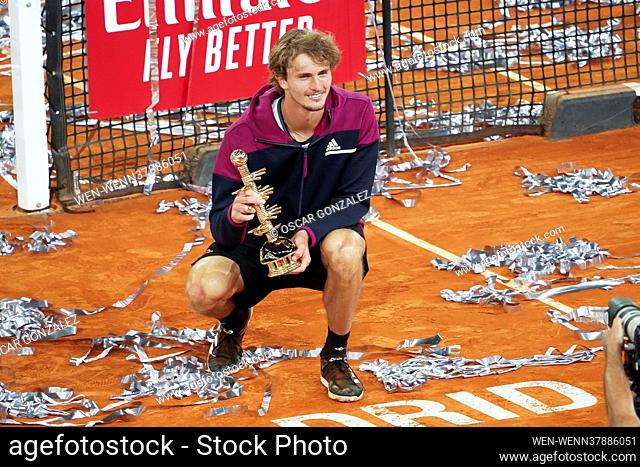 Alexander Zverev of Germany celebrates with the trophy following victory against Matteo Berrettini of Italy in the Mutua Madrid Open Final on day eleven of the...