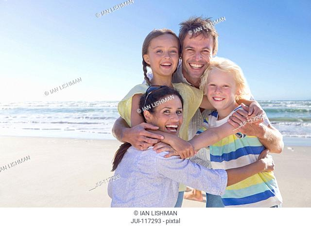 Portrait Of Family Having Fun On Beach Vacation Together